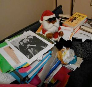 """The Leaning Tower of Rose Hovick:"" all of my research materials for my book MAMA ROSE'S TURN, topped with a Santa."