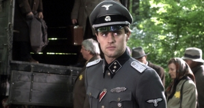 Clothes really do make the man!  A Jewish man pretends to be a Nazi to free other Jews in WALKING WITH THE ENEMY.