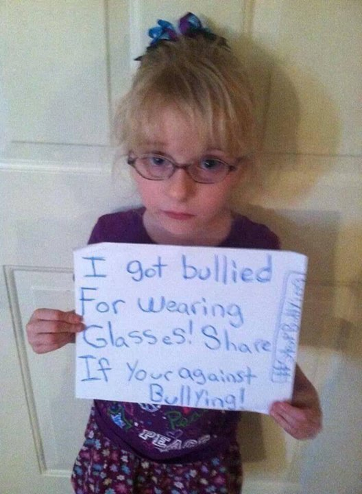 photo of a cute little girl who was bullied for wearing glasses