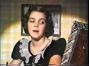 "Andrea McArdle, as Judy Garland, sings ""Dear Mr. Gable"" to Clark Gable at his birthday party."