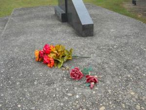 Flowers left at the memorial.