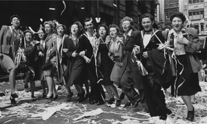 Revelers after an impromptu ticker-tape celebration, New York City, 70 years ago today.
