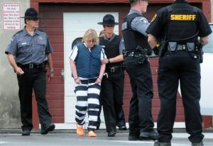 From sweet-talked to stripes: Joyce Mitchell's in custody while the prisoners still run free.