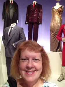 Surprise, surprise! Me standing in front of the very costumes worn by Richard Gere (the red suit) and Queen Latifah (the gold dress) in my favorite movie, CHICAGO!