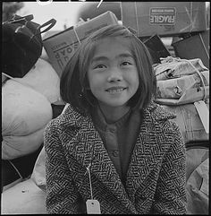 Dorothea Lange took this photo of a child about to be evacuated from Hayward, CA in 1942.  Who was this little girl?