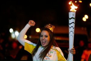 An Olympic torch-bearer having a fabulous time!